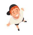 smiling teenage boy character in cap looking up vector image vector image