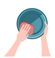 hands washing the dishes a plate vector image