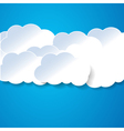 paper clouds on the blue vector image