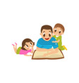 dad reading a book to his son and daughter family vector image