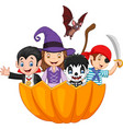 cartoon kids with halloween costume inside pumpkin vector image