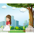 A woman using her gadget in front of the buildings vector image vector image