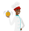 young african-american chef holding alarm clock vector image vector image