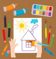 child draws at the desk vector image