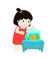cute little girl feeding fish in aquarium cartoon vector image vector image