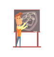 handsome scientist standing next to blackboard vector image vector image