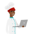 young african-american chef using a laptop vector image vector image