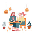 young pretty girls sitting in cafe chatting vector image