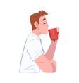 young man drinking tea or coffee guy enjoying vector image