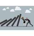 Business man and business woman pushing hard vector image vector image