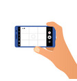 hand holding the smartphone and taking a photo vector image vector image