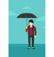 Businessman standing with umbrella vector image vector image