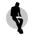 silhouette of man sitting reading holding a book vector image