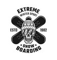 snowboarding emblem with skull and two boards vector image vector image