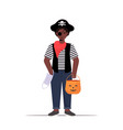 Guy wearing pirate costume holding bucket with