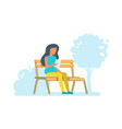 girl sitting in a park vector image