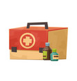 first aid kit with tablet bottles isolated on vector image vector image