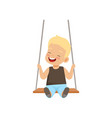 happy smiling boy swinging on a rope swing little vector image vector image