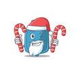 hot water bag cartoon character in santa costume vector image vector image