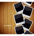Photo frames on wooden texture vector image