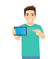 young man showing tablet vector image