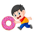 a boy pushing big donut vector image vector image