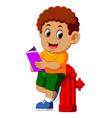 happy boy reading book vector image vector image