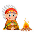 male north american indian sitting before a fire vector image vector image