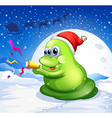 A monster with a red hat playing at the snowy land vector image vector image