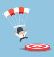 Businessman with a parachute landing on a target vector image vector image