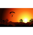 Person Parachuting in the Sunset vector image