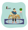 boy plays puzzle games at home at table vector image