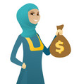 young muslim business woman holding a money bag vector image vector image