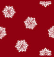 red seamless pattern with a snowflake vector image vector image