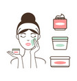 woman applies fresh organic creams on her face vector image