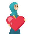 young muslim business woman holding a big heart vector image vector image