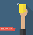 Hand of referee showing yellow card vector image