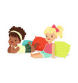 two sweet little girls sitting and lying on the vector image vector image