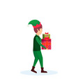 christmas boy carry gift box elf santa helper vector image