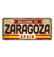 welcome to zaragoza vintage rusty metal sign vector image vector image