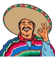 Smiling Mexican man in sombrero and poncho showing