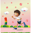 A boy jogging at the candyland vector image vector image