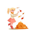 kid girl plays with autumn leaves throwing them up vector image