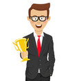 successful cute businessmanholding golden trophy vector image vector image