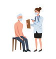 female doctro attending old man in chair vector image vector image