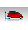 red electric car with charging station vector image vector image