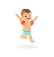 cute happy boy running with inflatable armbands vector image vector image