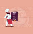 african american chef cook holding restaurant menu vector image vector image
