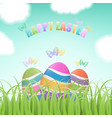 easter eggs behind grass vector image vector image