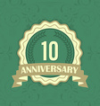 10th anniversary label on a green ornament vector image vector image